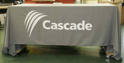 Grey six foot Tradeshow Tablecloth with Logo and white text.