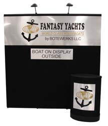 Black eight foot Portable Pop Up Display with Header Banner.