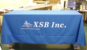 Blue, Six Foot Custom Tablecloth and Logo with White Letters.